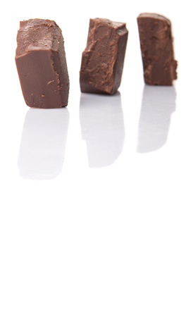 chocolate pieces: Dark brown chocolate pieces over white background