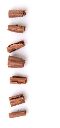 curls: Chocolate curls over white background