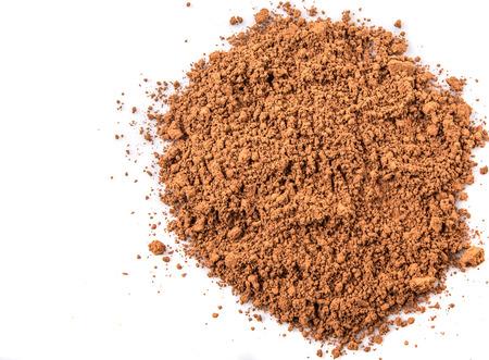 Cocoa powder over white background