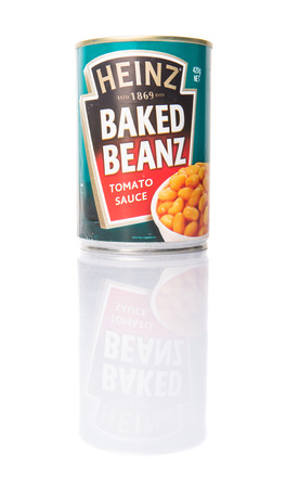 food processing: PUTRAJAYA, MALAYSIA - APRIL 4TH, 2015. Heinz baked beans. Founded in 1888, The H.J. Heinz Company, or Heinz, is an American food processing company. Heinz products are sold in more than 200 countries.