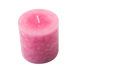 aromatic: Pink colored aromatic candle over white background Stock Photo