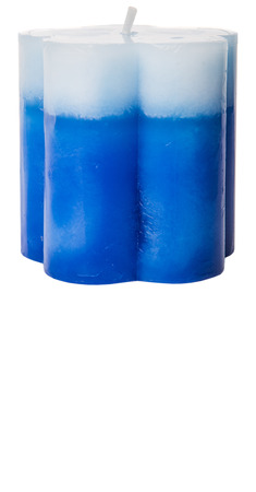aromatic: Blue colored aromatic candle over white background