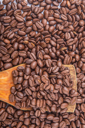 stimulate: Roasted coffee beans on wooden spatula Stock Photo