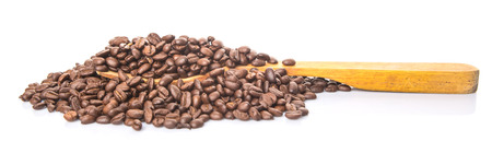 cash crop: Roasted coffee beans on wooden spatula Stock Photo