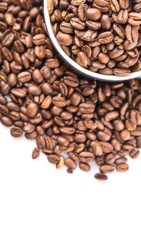 stimulate: Roasted coffee beans in a blue ceramic pot over white background Stock Photo