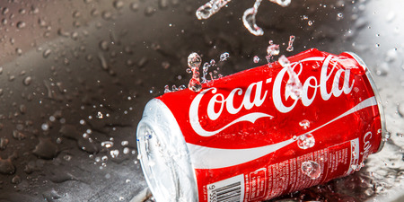 KUALA LUMPUR, MALAYSIA - JANUARY 31ST, 2015. Water droplets on Coca Cola can. Coca Cola drinks are produced and manufactured by The Coca-Cola Company, an American multinational beverage corporation.