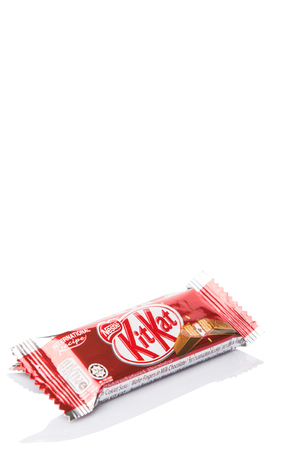 globally: KUALA LUMPUR MALAYSIA, APRIL 21ST 2015. Kit Kat is a chocolate covered wafer bar created in 1911 by Rowntrees of York, England. Nestle which acquired Rowntree in 1988 now sells Kit Kat globally.