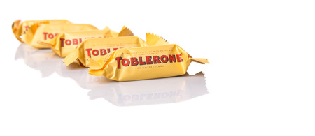 chocolate peak: KUALA LUMPUR, MALAYSIA - APRIL 22ND, 2015. Created by Theodor Tobler in 1908,  Toblerone is a Swiss triangular chocolate bar brand owned by American Mondelez International.
