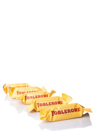 chocolate peak: KUALA LUMPUR, MALAYSIA - APRIL 22ND, 2015. Created by Theodor Tobler in 1908,  Toblerone is a Swiss triangular chocolate bar brand owned by American Mondelez International.