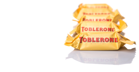 toblerone: KUALA LUMPUR, MALAYSIA - APRIL 22ND, 2015. Created by Theodor Tobler in 1908,  Toblerone is a Swiss triangular chocolate bar brand owned by American Mondelez International.