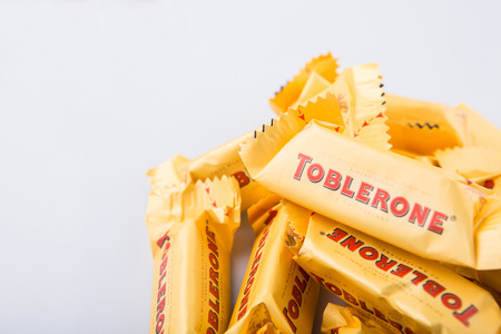 KUALA LUMPUR, MALAYSIA - APRIL 22ND, 2015. Created by Theodor Tobler in 1908,  Toblerone is a Swiss triangular chocolate bar brand owned by American Mondelez International.