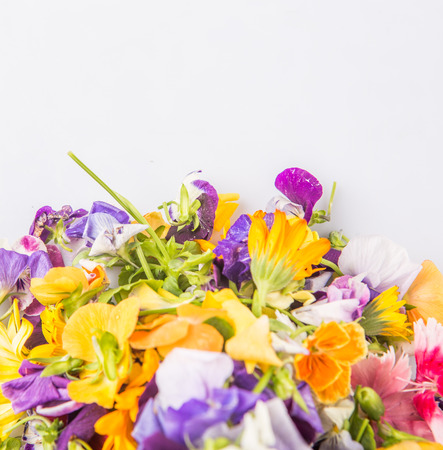 Mix edible flower salad over white background