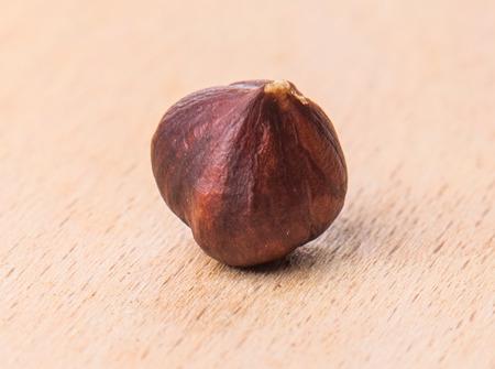 cobnut: Hazelnut on wooden cutting board