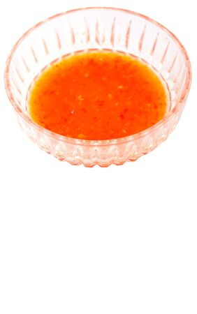 sweet and savoury: Homemade chili sauce in a bowl over white background