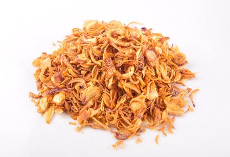 Deep fried shallots for garnishing over white background Standard-Bild