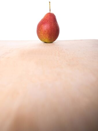 bell shaped: South African forelle pear fruit on wooden surface