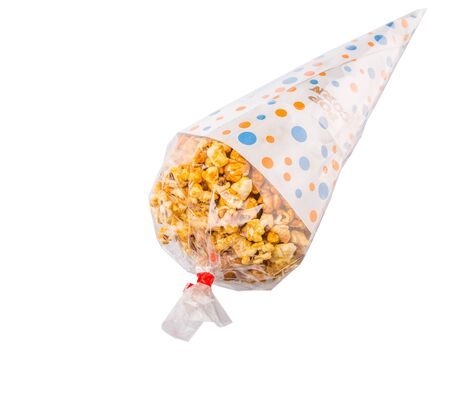 starchy food: Caramel popcorn in a paper cone pack over white background Stock Photo