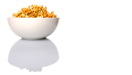 starchy food: Caramel popcorn in white bowl over white background