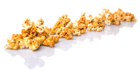 yellowrn: Caramel popcorn over white background