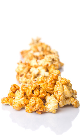 starchy food: Caramel popcorn over white background