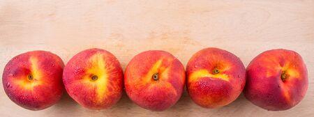 yellowrn: Nectarine fruit on wooden surface