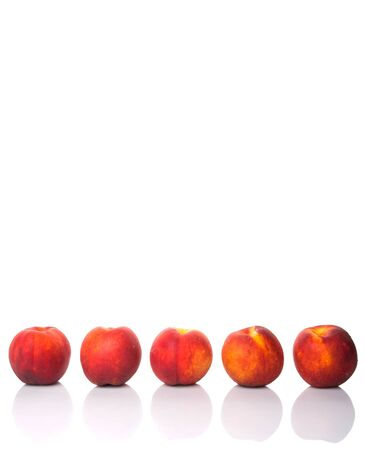 velvety: Nectarine fruits over white background Stock Photo