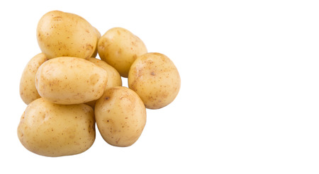 Baby potatoes over white background Фото со стока