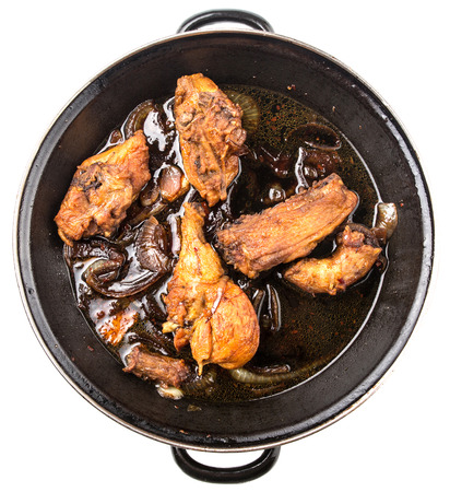 saute: Malaysian dish of deep fried chicken in with black soy gravy in a saute pan