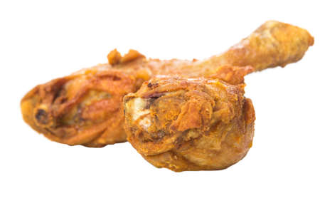joins: Deep fried chicken drumsticks over white background