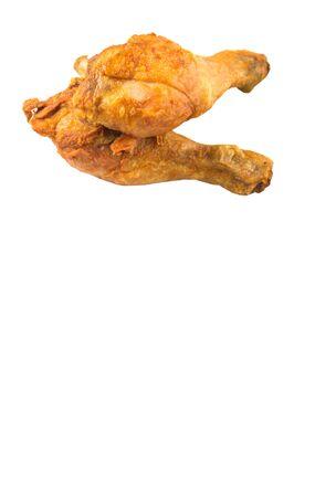 Deep fried chicken drumsticks over white background photo