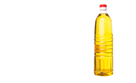 cooking oil: Vegetable cooking oil in a plastic bottle over white background
