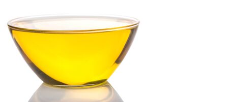 cooking oil: Vegetable cooking oil in a clear glass bowl over white background