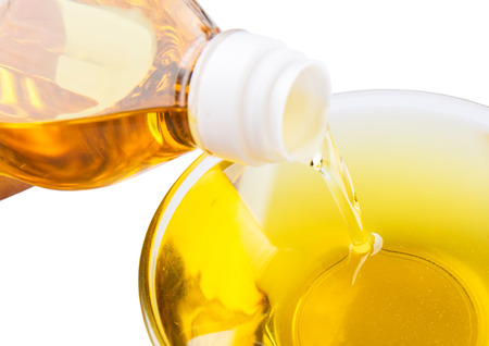 cooking ingredients: Vegetable cooking oil in a clear glass bowl over white background