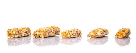caramelized: Caramelized candy nuts over white background