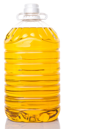 Cooking palm oil in large plastic container over white background