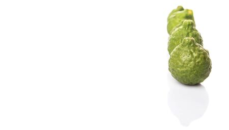 wrinkled rind: Kaffir or makrut lime over white background Stock Photo