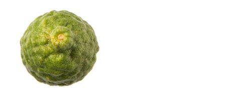wrinkled rind: Kaffir or makrut lime over white background Stock Photo