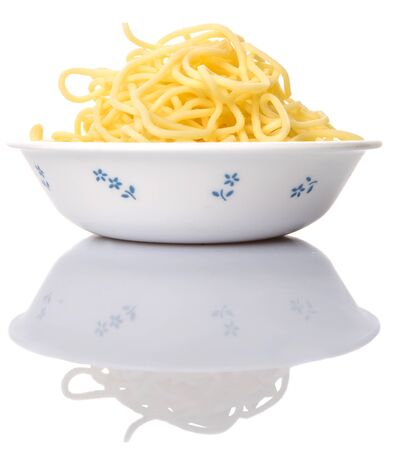 mee pok: Raw long chinese yellow noodles in white bowl over white background