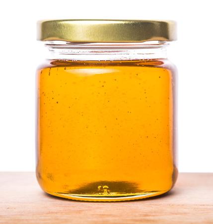 Honey in a mason jar on a wooden background Standard-Bild
