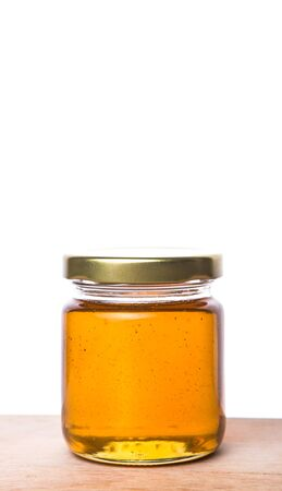 curative: Honey in a mason jar on a wooden background Stock Photo