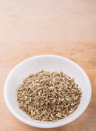cumin: Cumin seed in white bowl