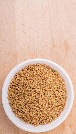 fenugreek: Fenugreek seed in white bowl