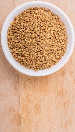 methi: Fenugreek seed in white bowl