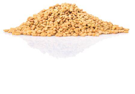 methi: Fenugreek seeds over white background Stock Photo