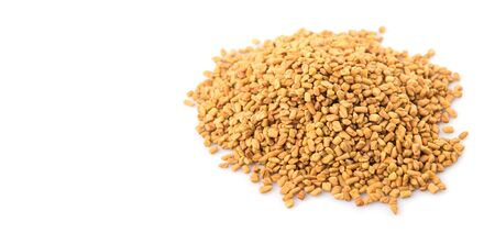 fenugreek: Fenugreek seeds over white background Stock Photo
