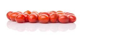 sized: Bite sized red cherry grape tomato over white background