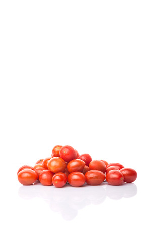 sized: Bite sized red cherry grape tomato over white background