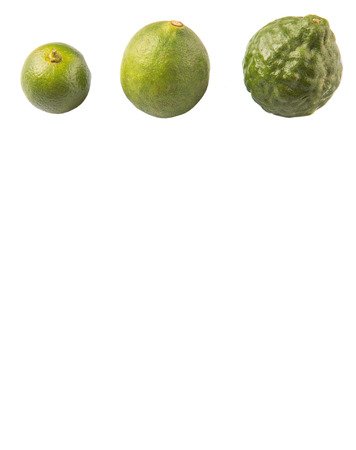 acidity: Lime makrut or kaffir lime and calamansi over white background Stock Photo