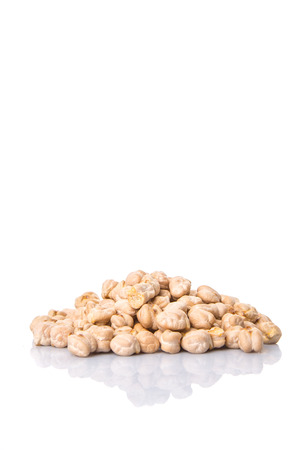 Raw chickpeas over white background photo