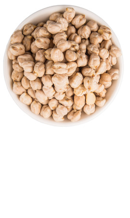 Chickpeas in a white bowl over white background photo